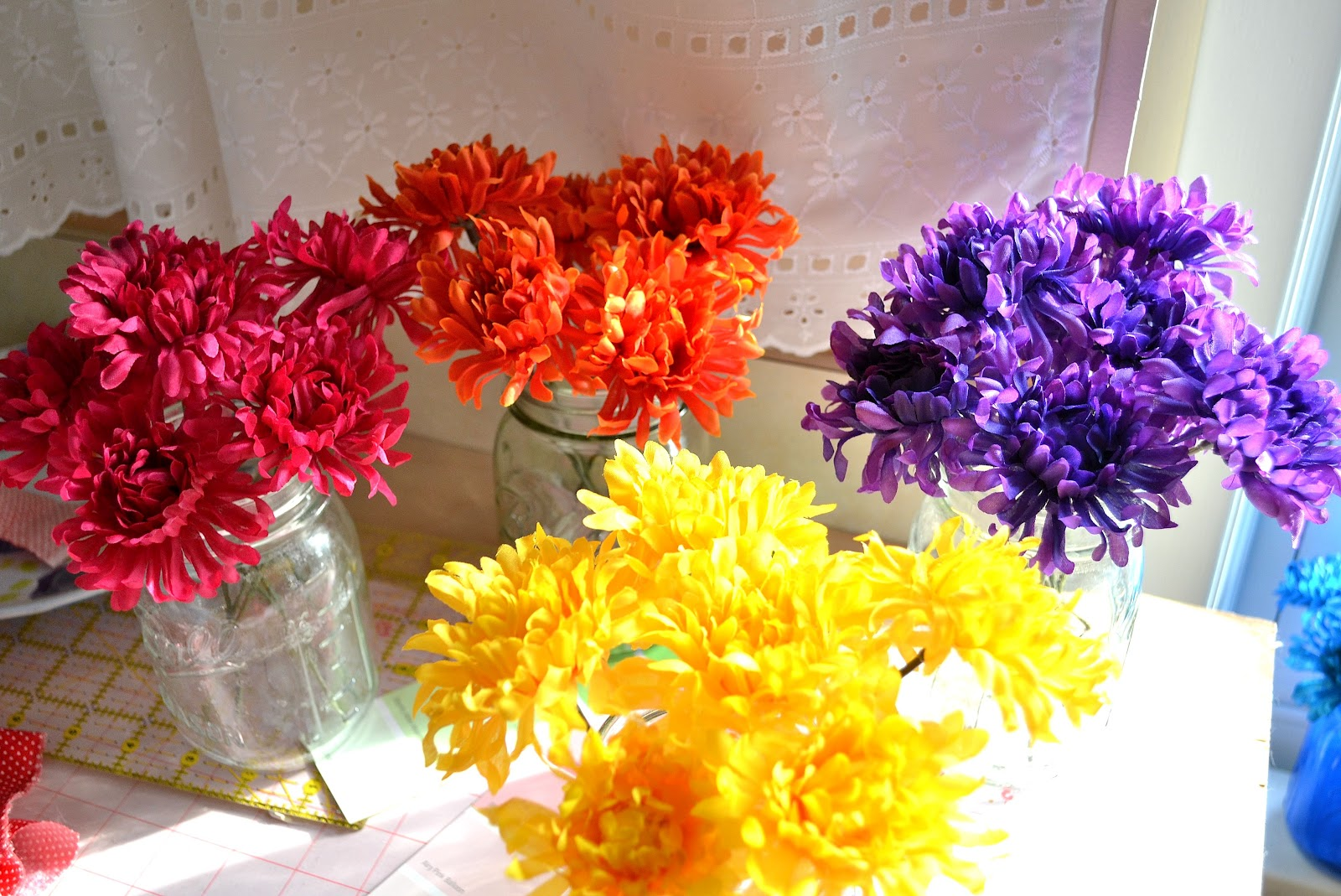 From The Hive: colored flowers in colored jars