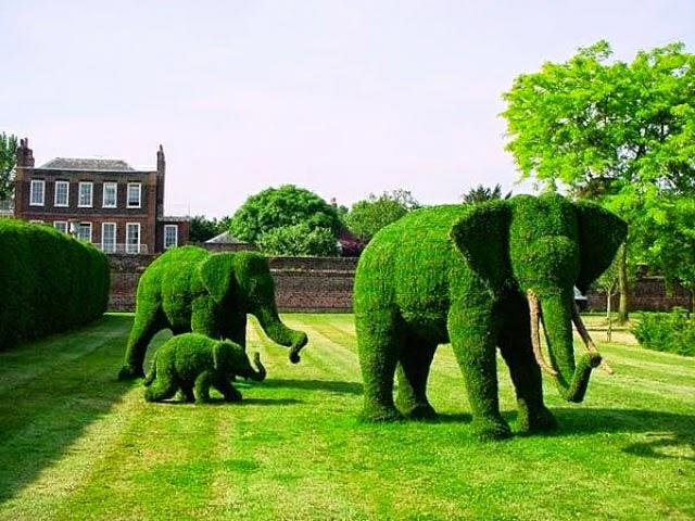 Jardins d 39 exception les personnages disney transform s en - Jardin topiaire ...