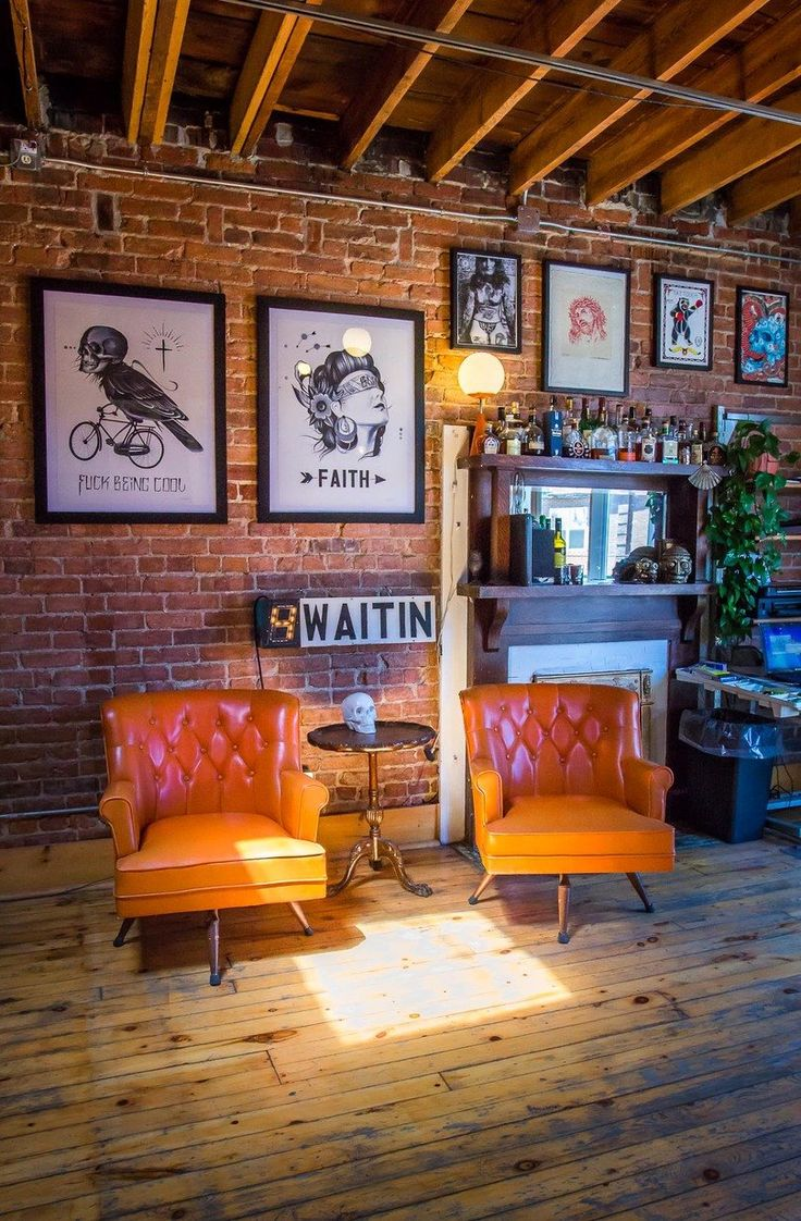 I de a red brick walls in the living room for Tattoo shop design