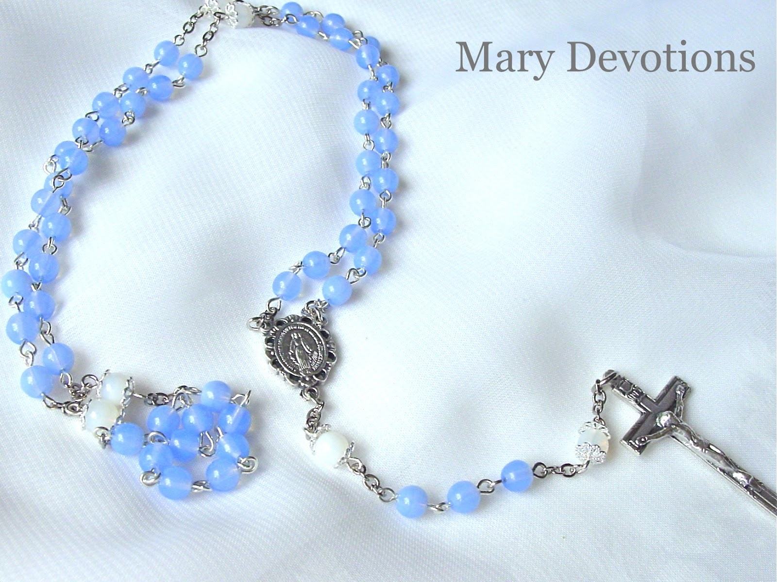 The Hail Mary Beads Are 6mm Opal Blue Czech Glass And Our Father White With Silver Flower Caps Rosary Is A Link Style