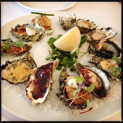 A picture of the Oyster Tasting Plate at Luke Benchmark