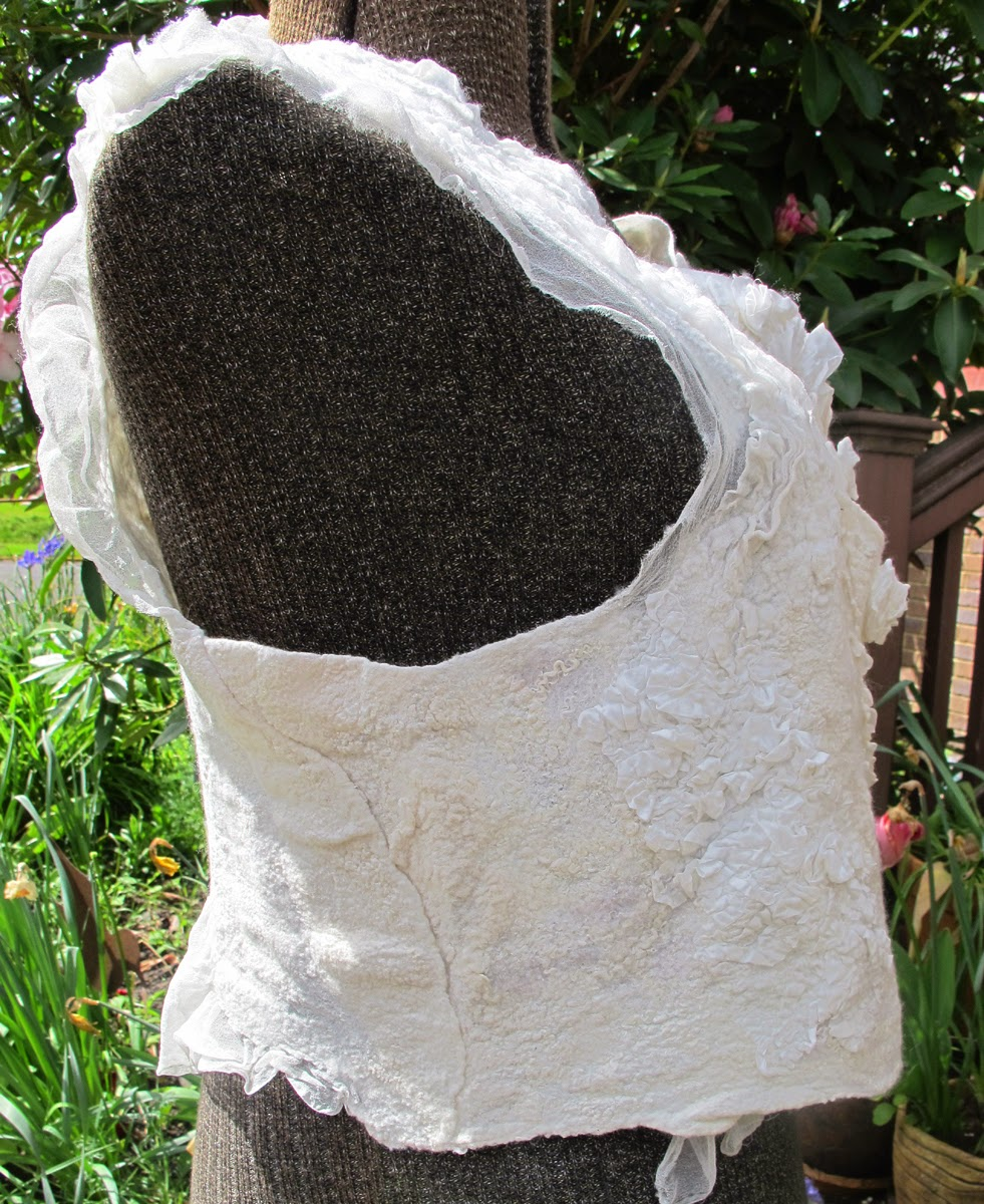 Pat Spark white felt vest from the side
