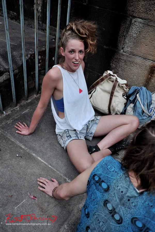 White singlet, denim shorts purple boob tube - 80s style. NAS art opening, Street Fashion Darlinghurst Sydney.
