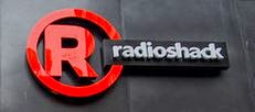 Image of a Radio Shack logo with a red capital R in a red circle with words radioshack next to it