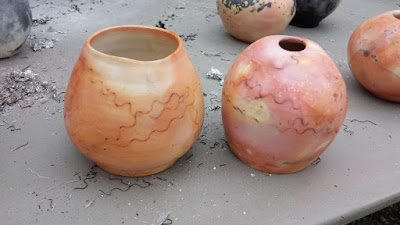 Beautiful saggar fired raku pottery.