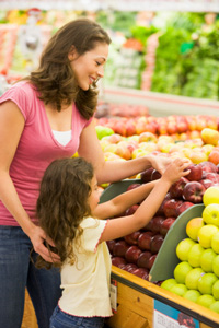 mother and daughter buying groceries