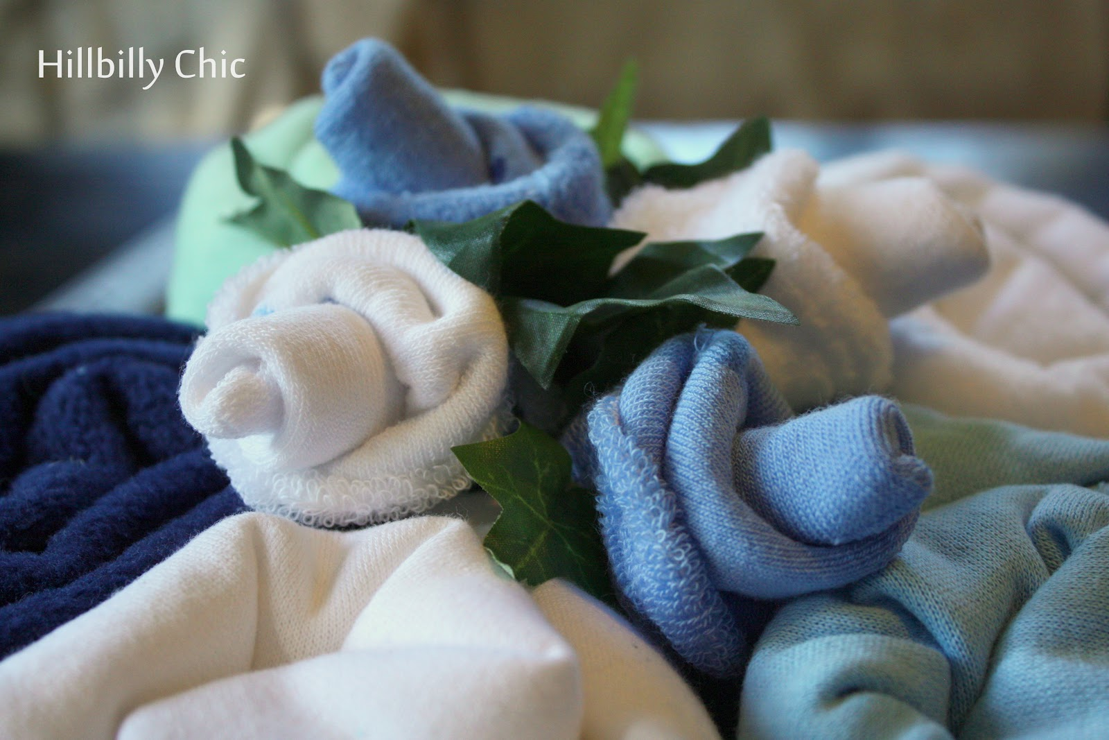 Hillbilly chic baby blanket cake baby shower gift i found a video on youtube that had step by step instructions on how to make the sock flowers they were suprisingly easy although they were the most negle Images
