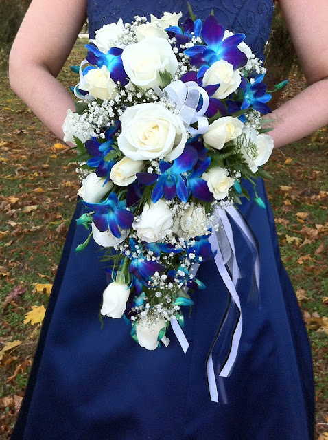Blue orchid and white rose bridal cascade by Stein Your Florist Co.