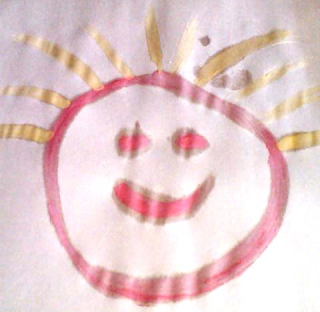 Happy face drawn with pink watercolor paint with yellow hair.