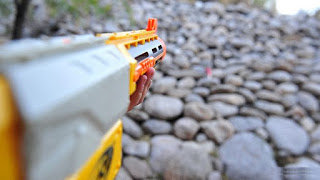 Aim above the target slightly, nerf darts drop over distance.