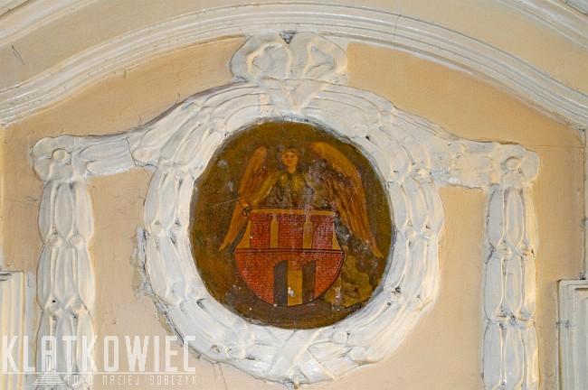 Toruń: herb miasta na klatce schodowej
