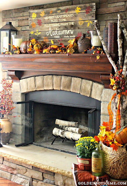 palllet sign and lantern with birch logs on stone fireplace, part of fall mantel via www.goldenboysandme.com
