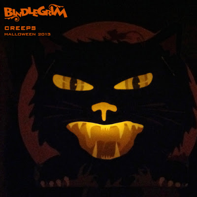 Bindlegrim Creeps are vintage style Halloween candy container lanterns featuring characters like a black cat in front of a full moon