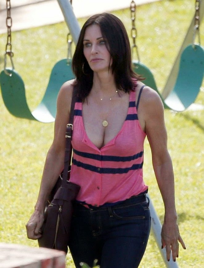 It would seem Courtney Cox had even looked to Grease for a little inspiration when it come to her sporty statement. Making her way to the Los Angeles set of the Cougar Town filming, the 50-year-old displayed her fit figure in a pair of dark spandex and a pink top.