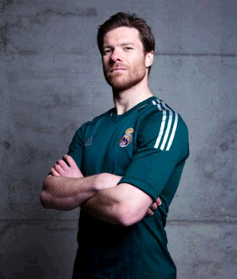Xabi Alonso wearing the Real Madrid green jersey 2012-2013