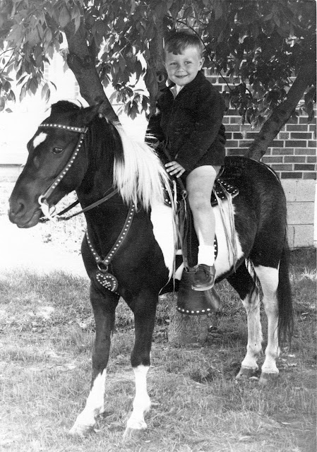 Photo of Anthony on a pony for his birthday
