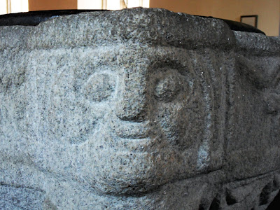 Faces on the font at Veryan church, Cornwall