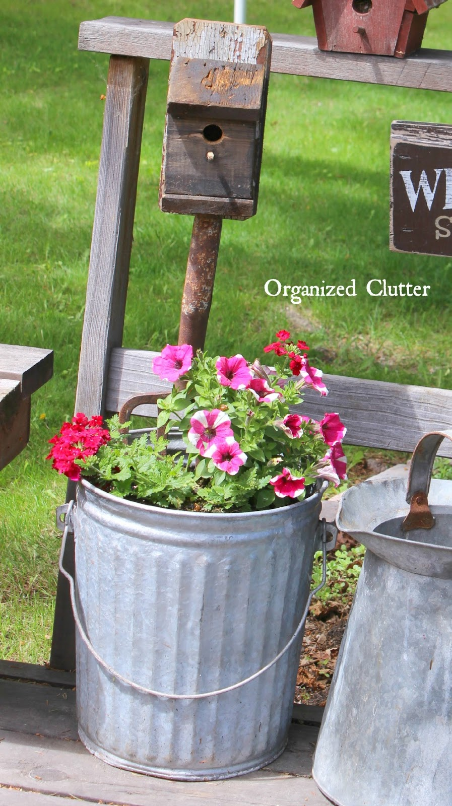 Organized Clutter Decorating the Deck with Rustic Birdhouses