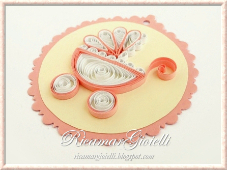 Carrozzina in quilling