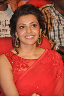 Actress Kajal Agarwal Latest Pictures in Red Saree at Govindudu Andarivadele Movie Audio Launch  006