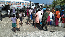 Cite Soleil, Haiti 2011: Water distribution truck surrounded by locals getting water