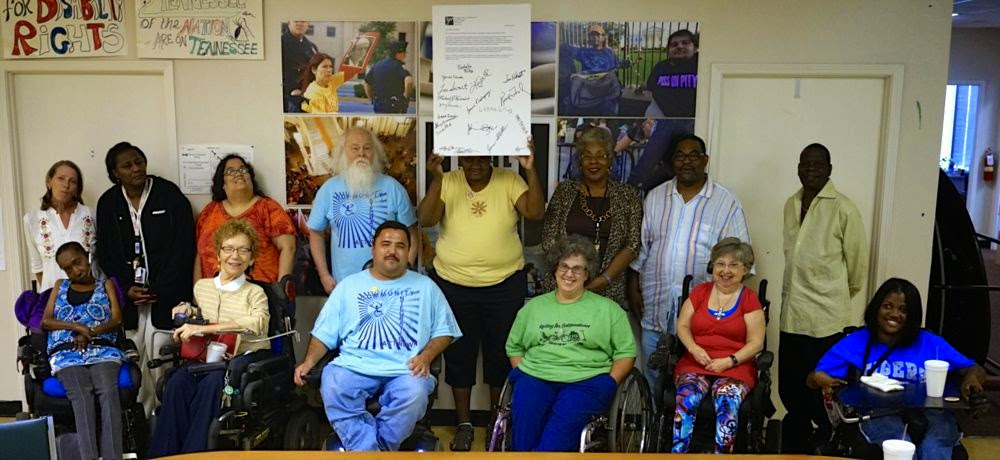 the Memphis Center for Independent Living  staff holding the signed letter to Sen. Alexander