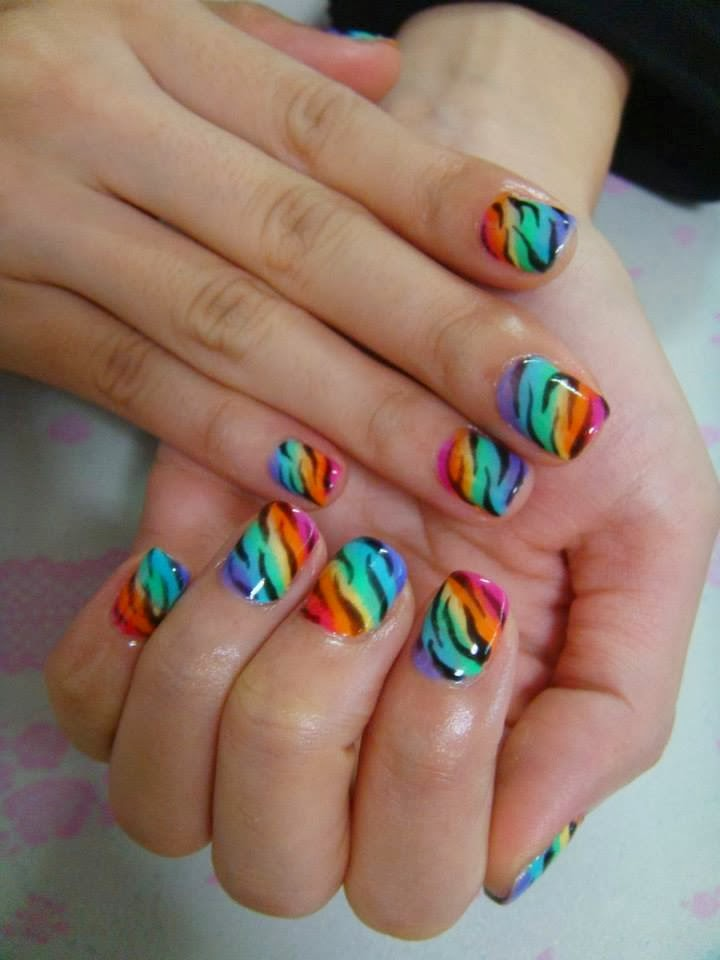 A set of clear tip acrylic extensions Gel-color Manicure on the natural nail-rainbow neon zebras.jpg