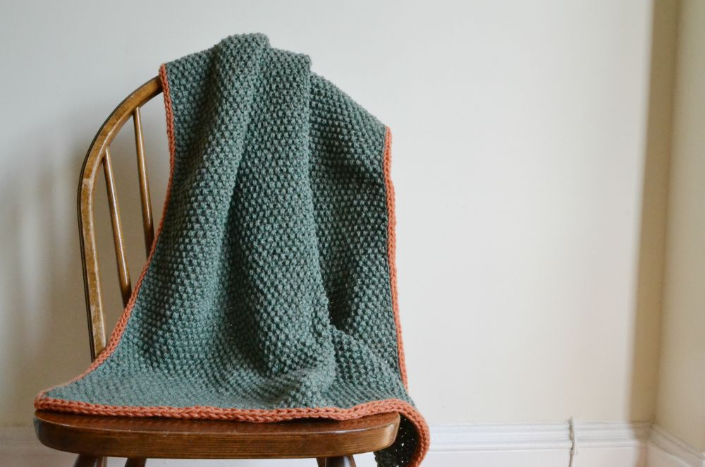 moss stitch blanket baby green orange knitted