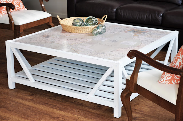 Dad repainted the timber base white which gives it a fresh, coastal feel  though it would also look great colour-matched with one of the muted  sea-greens or ... - The Painted Hive Coastal Map Covered Coffee Table