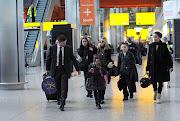 Madonna and Children Arrive at Heathrow Airport Yesterday (madonna and children heathrow airport )