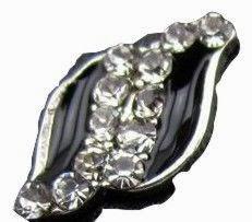 http://www.vitrine-beaute.com/bijoux/1418-bijou-ongle-noir-et-strass.htm