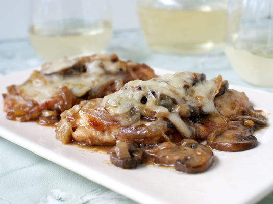Chicken topped with mushrooms, onions and gruyere