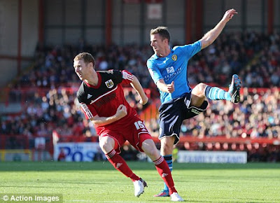 Michael Tonge drives home United's third