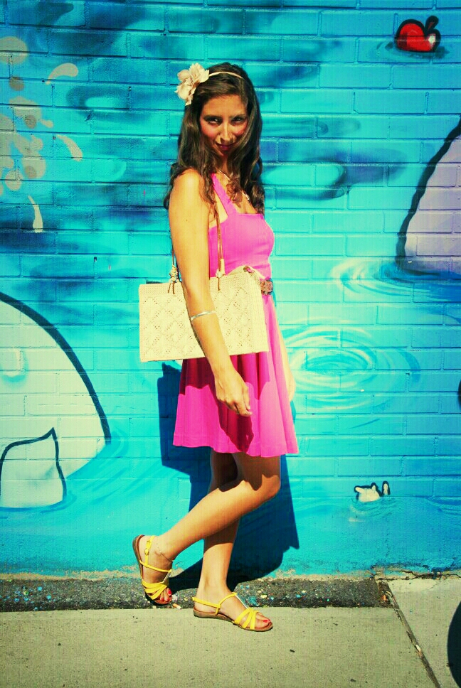 pink dress straw purse yellow sandals floral headband graffiti