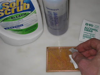Removing toner from PCB using cream bleach and alcohol swab