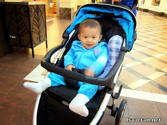 Matching blue outfit with the baby stroller.