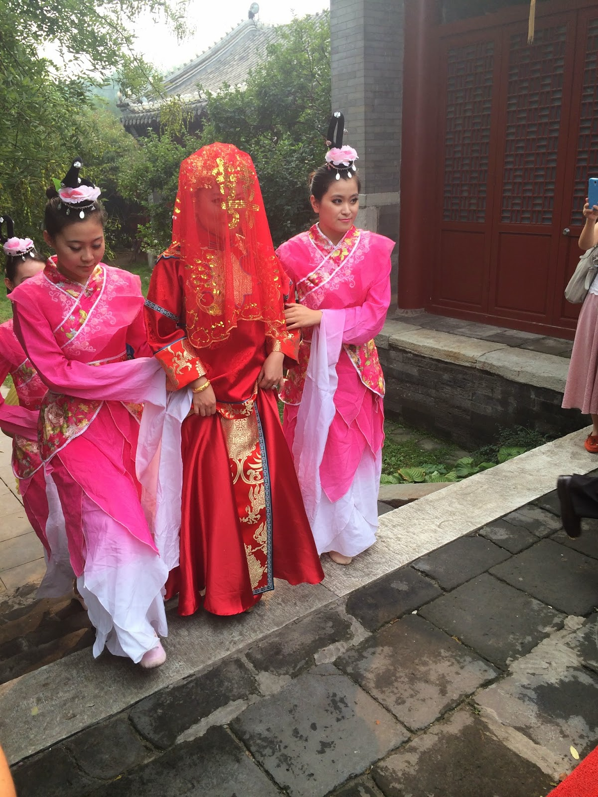 Traditional Chinese Wedding Ceremony - The ceremony itself involved the bride wearing an awesome cloak covered in peacock feathers too there wasn t any exchanging of vows but there were