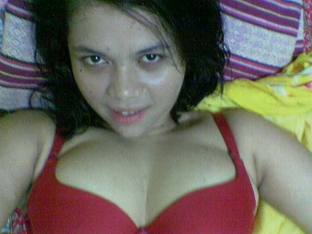 Brunette babe on bed