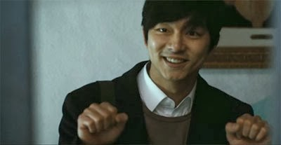 Gong Yoo as Kang In Ho, signs hello to the hearing impaired students he meets.