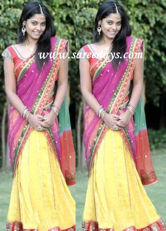 Latest saree designs bindu madhavi in pink and yellow netted langa voni bindu madhavi in pink and yellow netted langa voni altavistaventures Images