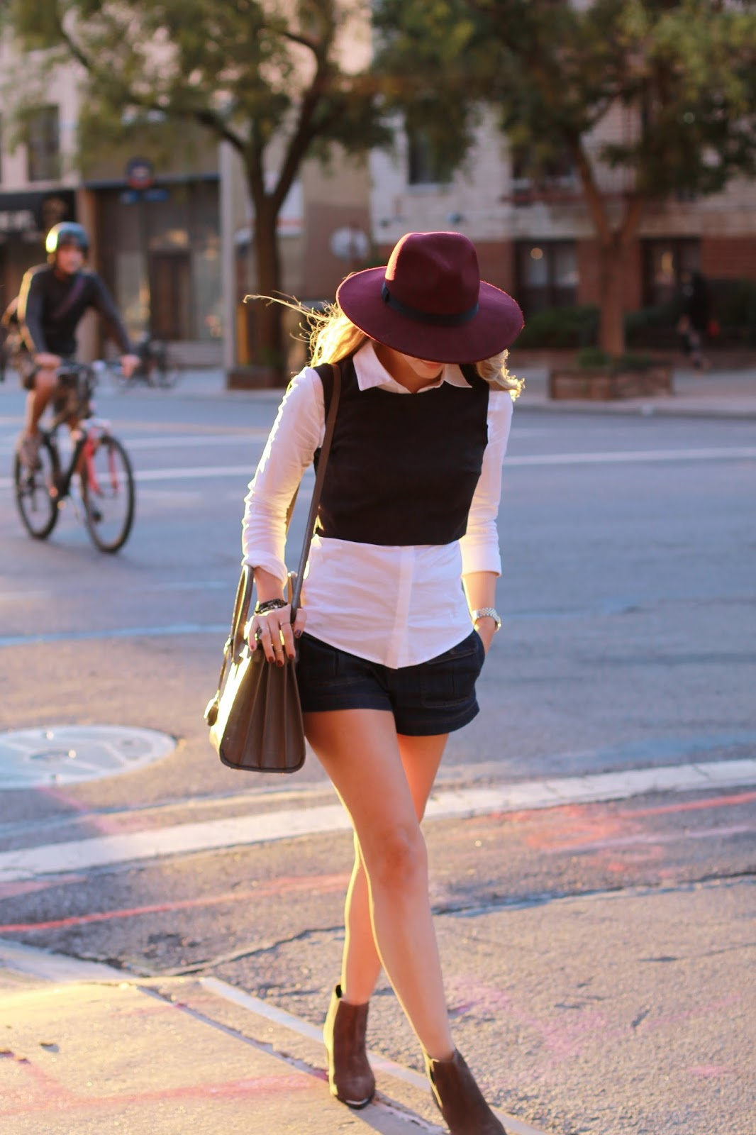 burgundy hat, button down and sweater shirt