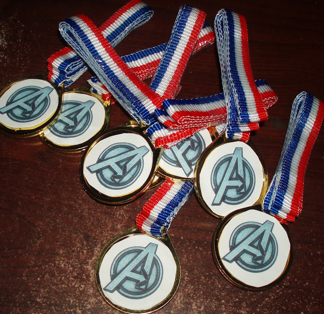 Toy medals with Avengers symbol