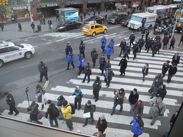 Police following a group of protesters at Union Square