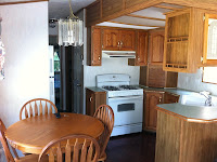 Kitchen in the rental trailer / cabin at Bare Oaks Family Naturist Park
