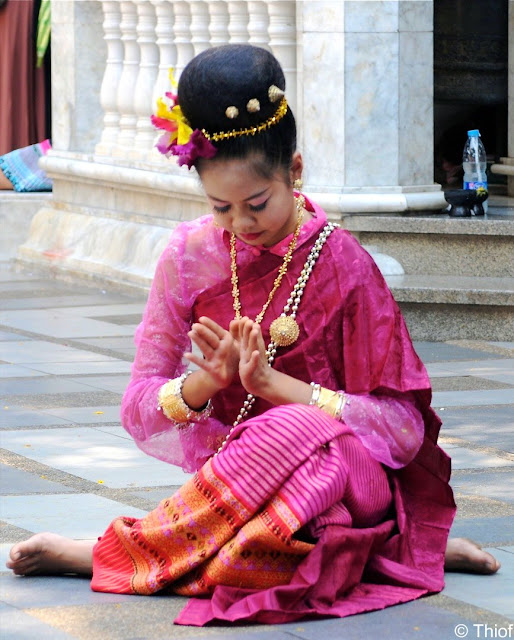 Woman praying in Thailand