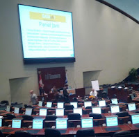shot of Council Chambers and screen in room saying Panel Jam
