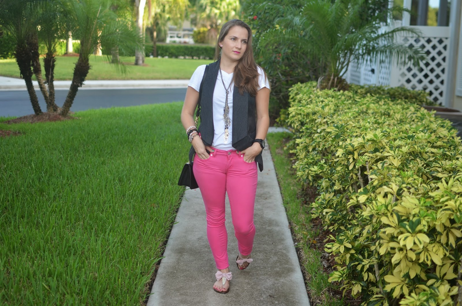 White tee - pink pants - vest - bow sandals - black crossbody