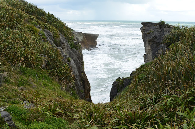 Powerful waves lash out from amid blowholes at Punakaiki, New Zealand