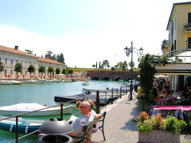 Pescheira del Garda at the southernmost point of Lake Garda is reminiscent of Venice with its quaint narrow streets and centuries-old canals.
