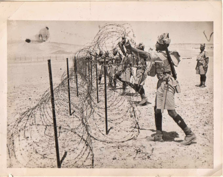 Indian Army Troops Stringing Barbed Wire in the North African Desert during Second World War - c1940's